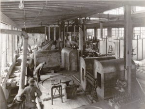 Figure 2 GSMW workers in the 1930s fabricate architectural metal. In the early days the fabricator made roofing and ventilation systems for the University of Notre Dame